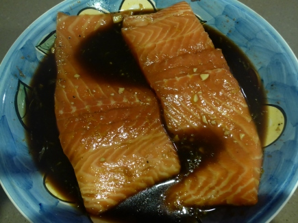 The salmon in the marinade.