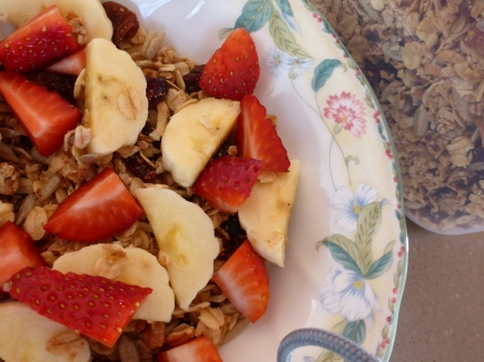 A serving of granola with fresh fruit