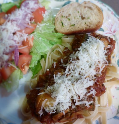 Dinner is served! Pasta with salad and garlic bread.