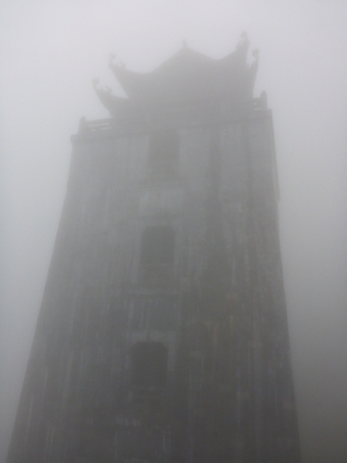 Can you see Dai Hong Chung Pagoda through the fog? 32.8m high, 5 floors and a bronze bell on each floor. Fanispan, Sapa